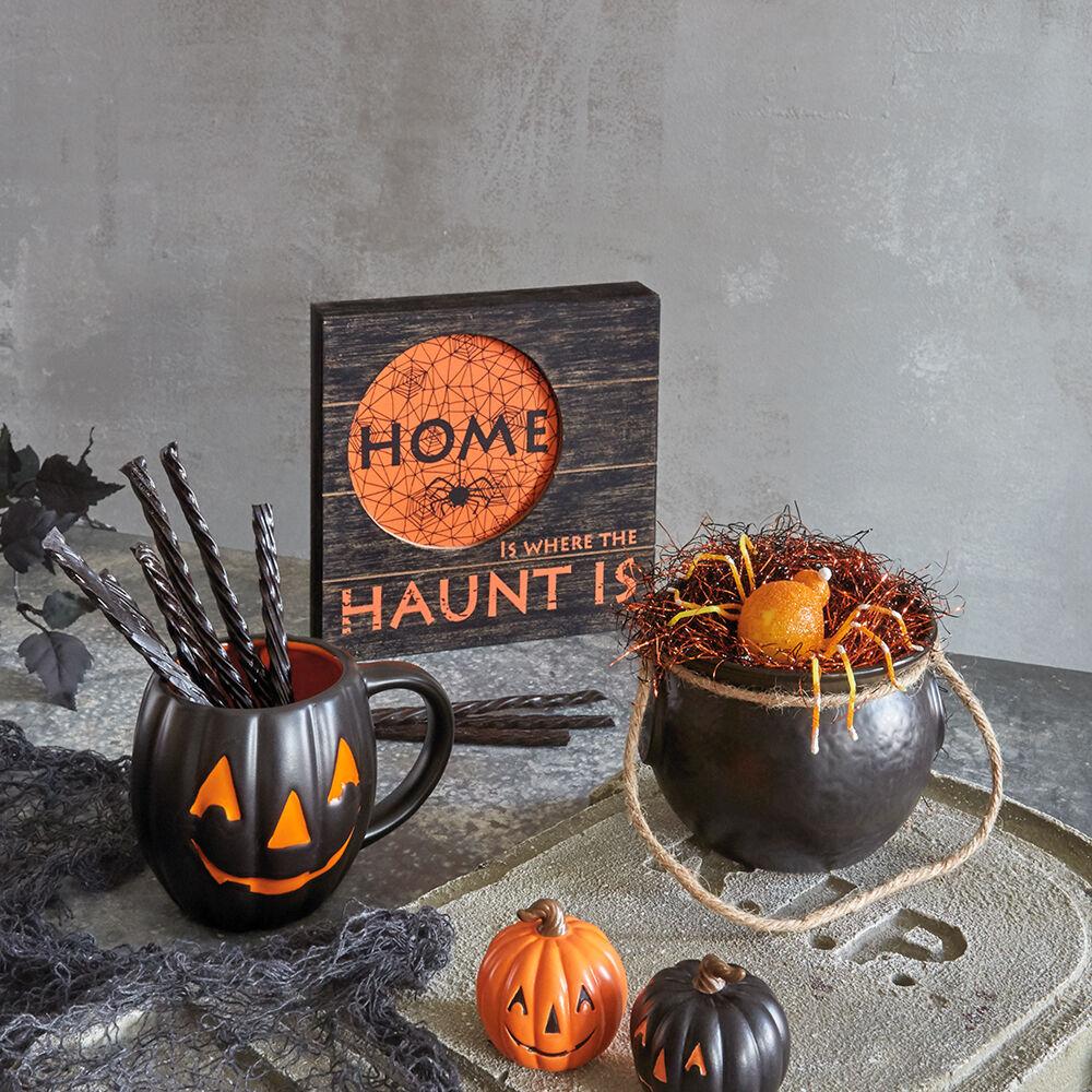Jack-o-lantern mug, witch's cauldron treat bowl and Halloween home rustic wood sign