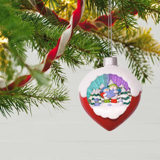 A Caroling Surprise Light and Music Ornament,