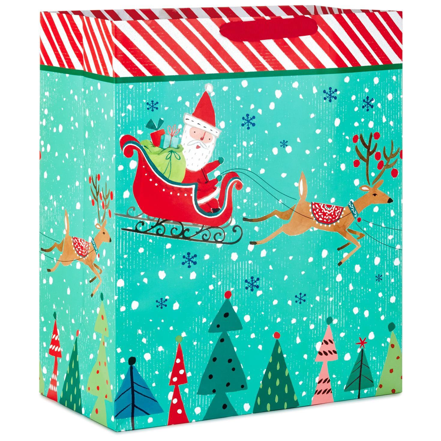 santa and sleigh with candy cane stripe jumbo christmas gift bag 20 gift bags hallmark