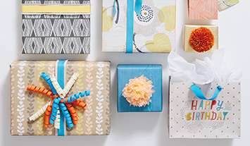 Gift wrap, bags and trim with bold patterns for mixing and matching