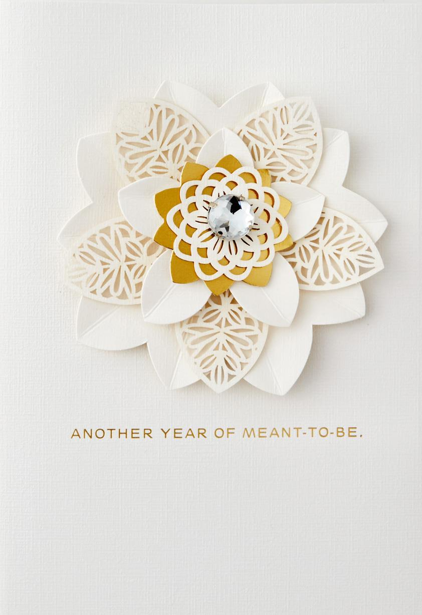 White and gold flower meant to be anniversary card for